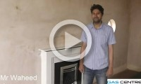 Mr Waheed stood next to one of his new fireplaces, supplied by Gas Centre